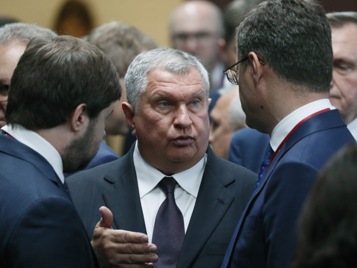 epa07632431 CEO of Rosneft oil company Igor Sechin (C) speaks with Russian Minister of Energy Alexander Novak (R) before beginning of Russian-Chinese Energy Forum on the sidelines of SPIEF 2019 Economic Forum in St. Petersburg, Russia, 07 June 2019.  EPA-EFE/YURI KOCHETKOV
