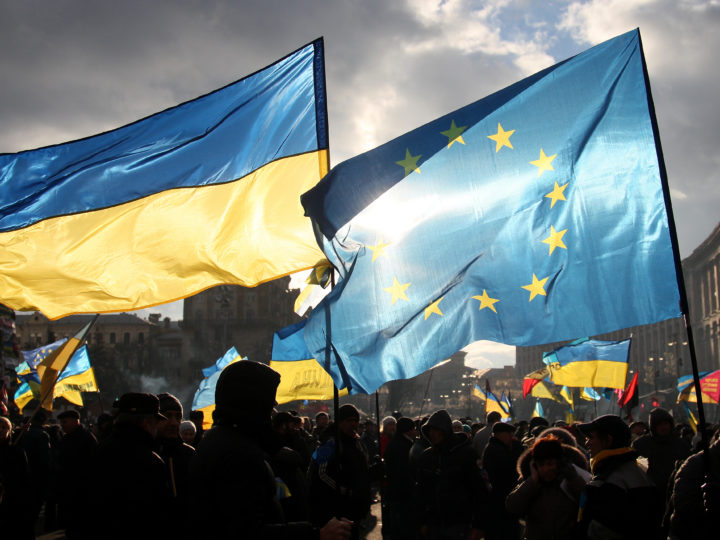 epa03977791 Two men hold EU and Ukrainian flags during the pro-European protests rally at Independent Square in Kiev, Ukraine, 05 December 2013. Thousands of protesters continued to demand the Ukrainian government's resignation in Kiev as foreign ministers of Europe's top security watchdog met there for talks. The ministerial council of the Organization of Security and Cooperation in Europe (OSCE) was overshadowed by some member country's open support for the host country's opposition.  EPA/ZURAB KURTSIKIDZE